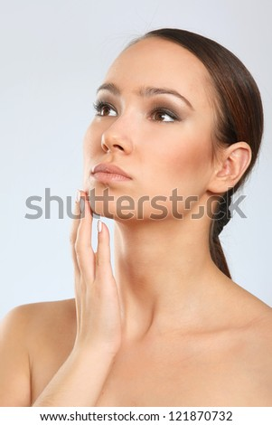 Close-up portrait of woman, isolated on white background - stock photo