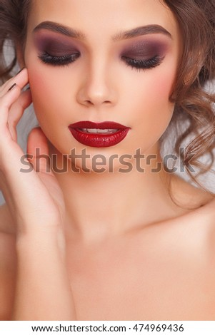 Close-up portrait of woman with beautiful face and fashion make-up - isolated. Skin care concept.