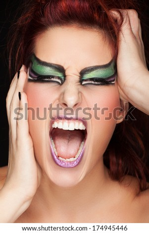 close up portrait of Woman with Make-Up with screaming face expression  - stock photo