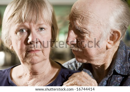 Close Up Portrait of Worried Senior Couple - stock photo