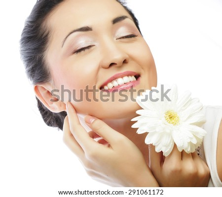 Close-up portrait of young asian woman holding white gerber flower isolated on white background. - stock photo