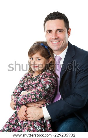 Close up portrait of young attractive businessman in suit with his little daughter on lap.Isolated on white background. - stock photo