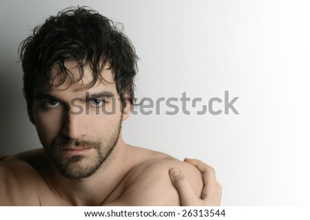 Close up portrait of young attractive man against white background