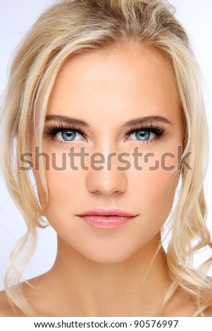 Close-up portrait of young beautiful blond girl with clear make-up - stock photo