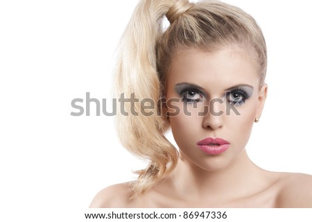 Close-up portrait of young beautiful blond woman with hair tail stylish and creative make up against white background - stock photo