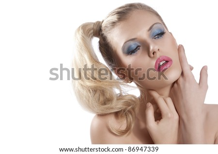 Close-up portrait of young beautiful blond woman with hair tail stylish and creative make up with sexy pose against while background - stock photo