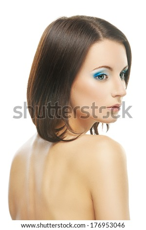 Close-up portrait of young beautiful dark-haired woman against white background. - stock photo