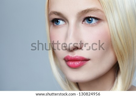 Close-up portrait of young beautiful fresh woman with bleached hair and clear make-up - stock photo