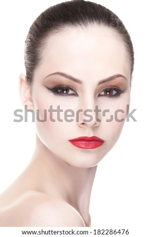 Close-up portrait of young beautiful girl with professional Make-up.Beautiful Face. Makeover. Perfect Skin. Isolated on a white background. - stock photo