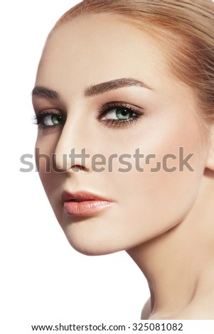 Close-up portrait of young beautiful healthy woman with stylish make-up over white background, copy space - stock photo