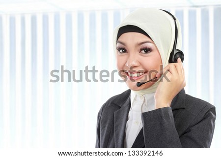 close up portrait of Young beautiful Muslim business woman while calling - stock photo