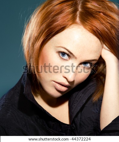 close up portrait of young beautiful red haired woman - stock photo