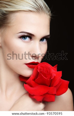 Close-up portrait of young beautiful sexy blond woman with red rose - stock photo