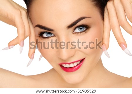 Close-up portrait of young beautiful smiling girl with stylish make-up and long nails - stock photo