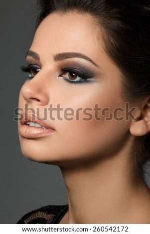 Close-up portrait of young beautiful tanned woman with arabic makeup