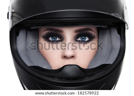 Close-up portrait of young beautiful woman in biker helmet over white background - stock photo