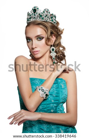 close up portrait of young beautiful woman in crown on white background