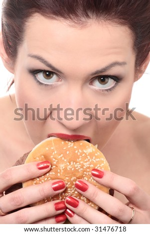 close-up portrait of young beautiful woman is eating big mac isolated on white - stock photo