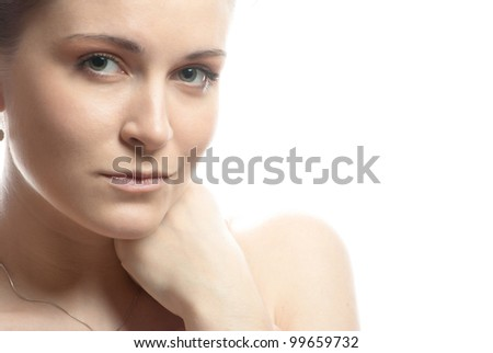Close-up portrait of young beautiful woman's face - stock photo