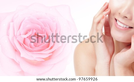 Close-up portrait of young beautiful woman smile mouth with pink rose flower background and touch her face, Model is a asian beauty - stock photo