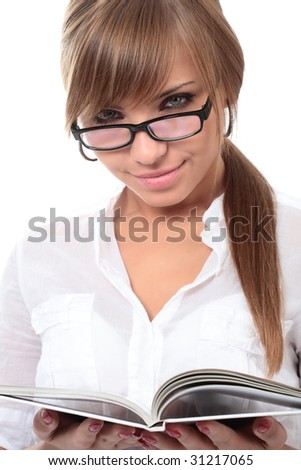 close-up portrait of young beautiful woman with book - stock photo