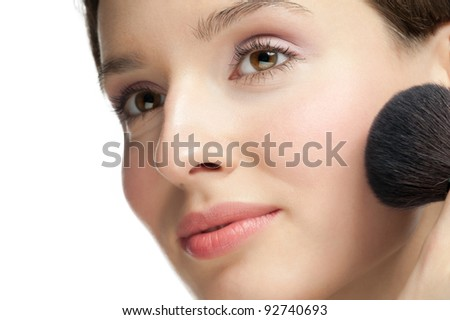 Close-up portrait of young beautiful woman with brush for make-up - stock photo