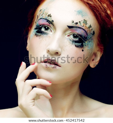 Close-up portrait of young beautiful woman with colorful bright  make-up - stock photo