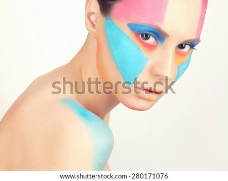 close-up portrait of young beautiful woman with paint on the face.Beauty make-up. Body art sexy girl - stock photo