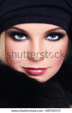 Close-up portrait of young beautiful woman with smoky eyes and huge fake eyelashes - stock photo