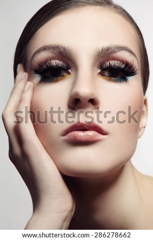 Close-up portrait of young beautiful woman with stylish make-up and fancy false eyelashes, selective focus - stock photo
