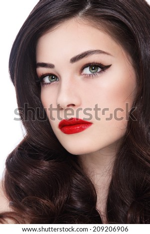 Close-up portrait of young beautiful woman with stylish make-up and long curly hair - stock photo