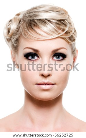 Close-up portrait of young blond woman - front view - stock photo