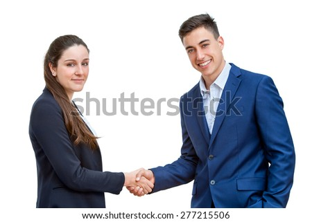 Close up portrait of young business couple dressed in blue suits shaking hands.Isolated on white background. - stock photo
