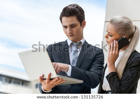Close up portrait of young business partners on outdoor meeting. - stock photo
