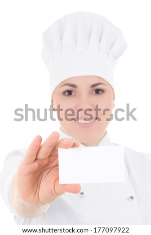 close up portrait of young cook woman in uniform showing visiting card isolated on white background - stock photo