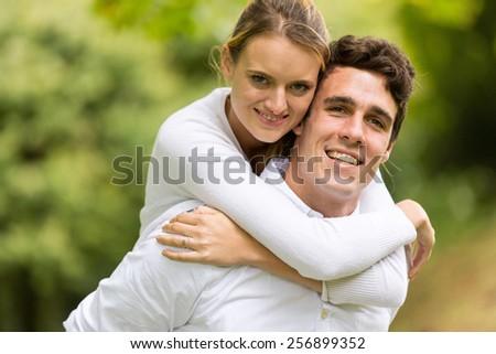 close up portrait of young couple enjoying beautiful day - stock photo