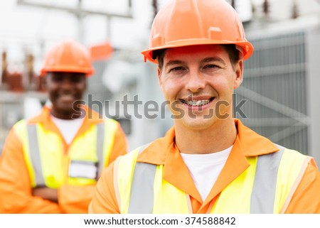 close up portrait of young electrical engineer in substation - stock photo