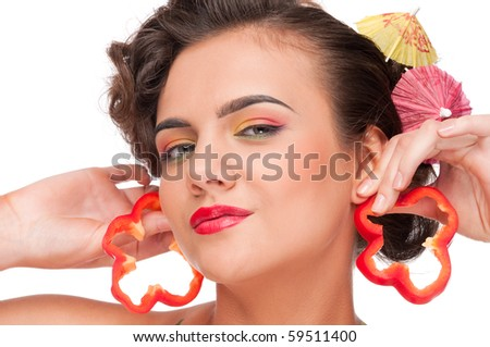 Close up portrait of young emotional beauty woman with pieces of red pepper. Perfect skin! Isolated on white. - stock photo