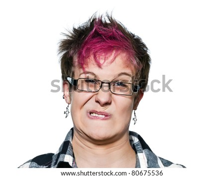 Close-up portrait of young expressive irritated woman making a face in studio on white isolated background - stock photo