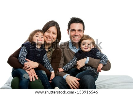 Close up portrait of young family on couch.isolated. - stock photo
