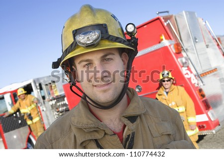 Close-up portrait of young firefighter - stock photo