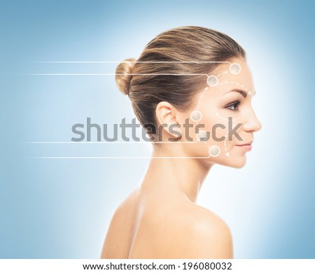Close-up portrait of young, fresh and natural woman with the dotted arrows (spa, surgery, face lifting and make-up concept) - stock photo