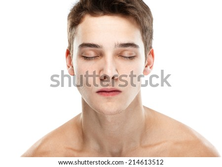 Close-up portrait of young handsome man with closed eyes isolated on white background - stock photo