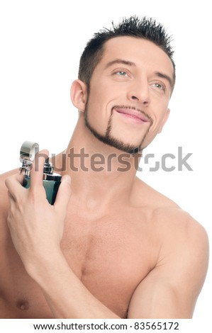 Close up portrait of young handsome man with perfect skin applying perfume. Isolated on white - stock photo