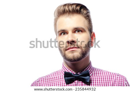 Close up portrait of Young handsome really surprised shocked man with bow tie isolated on white background - stock photo