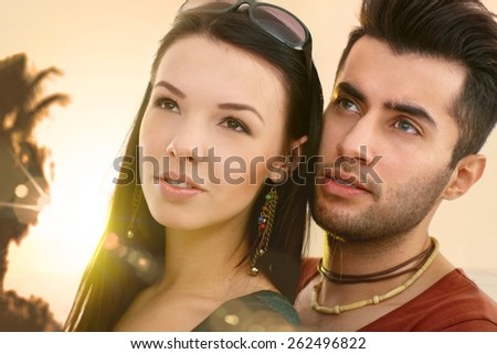 Close-up portrait of young loving couple looking away. - stock photo