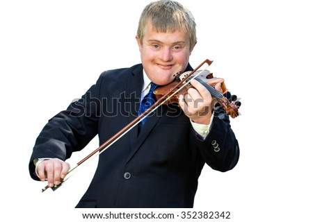 Close up portrait of young man with down syndrome playing violin. Handicapped  boy in suit isolated against white background.