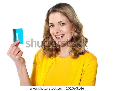 Close-up portrait of young smiling businesswoman holding credit card isolated on white background - stock photo