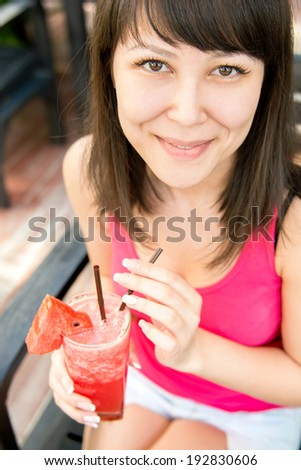 Close  up portrait of young smiling woman with the watermelon juice . Concept photo healthy eating and drinking - stock photo