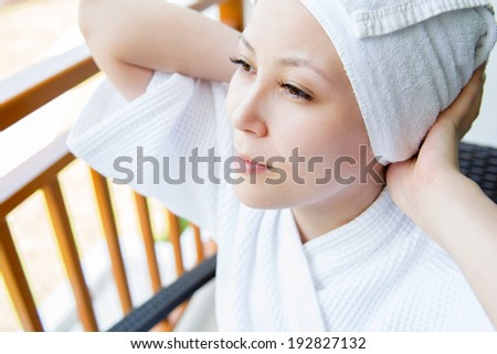 Close-up portrait of young smiling woman with towel hat , at home. Concept photo rest and comfort